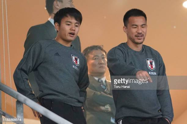 Takefusa Kubo and Shinji Okazaki of Japan looks on prior to the international friendly match between Japan and Trinidad and Tobago at Toyota Stadium...