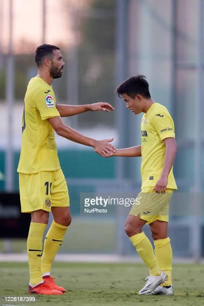 Takefusa Kubo and Vicente Iborra of Villarreal celebrates goal his teammate during the pre-season friendly match between Villarreal CF and FC...