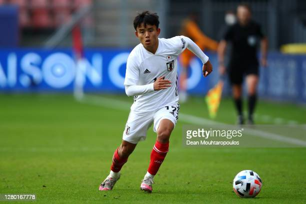 Takefusa Kubo o of Japan in action during the international friendly match between Japan and Ivory Coast at Stadion Galgenwaard on October 13 2020 in...