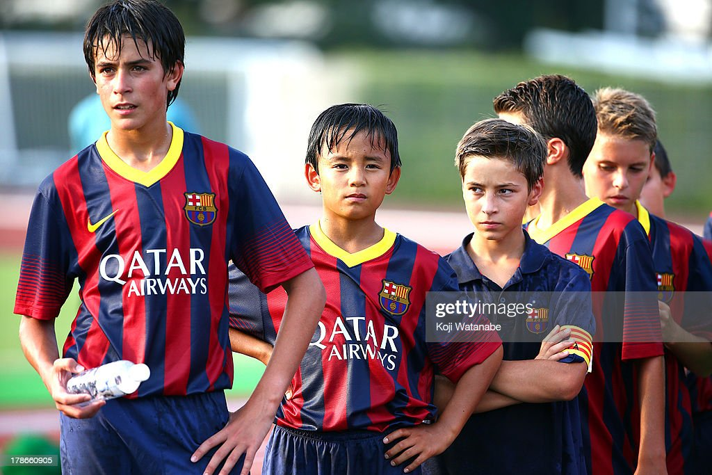 Takefusa Kubo (2L) of FC Barcelona Winner celebrate during the U-12 Junior Soccer World Challenge 2013 final match between FC Barcelona and Liverpool FC at Ajinomoto Stadium on August 30, 2013 in Tokyo, Japan.