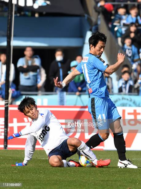 Takefusa Kubo of FC Tokyo and Akihiro Ienaga of Kawasaki Frontale compete for the ball during the JLeague J1 match between Kawasaki Frontale and FC...