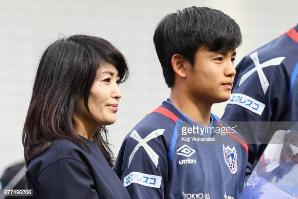Takefusa Kubo of FC Tokyo and his mother are seen prior to the JLeague Levain Cup Group A match between FC Tokyo and Consadole Sapporo at Ajinomoto...