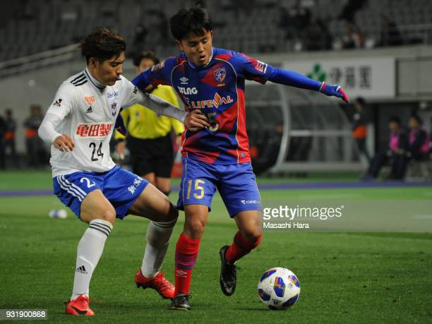 Takefusa Kubo of FC Tokyo and Naoki Kawaguchi of Albirex Niigata compete for the ball during the JLeague YBC Levain Cup Group A match between FC...