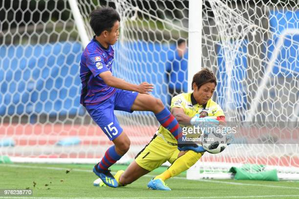 Takefusa Kubo of FC Tokyo and Park Irugyu of FC Ryukyu compete for the ball during the J.League J3 match between FC Tokyo U-23 and FC Ryukyu at...
