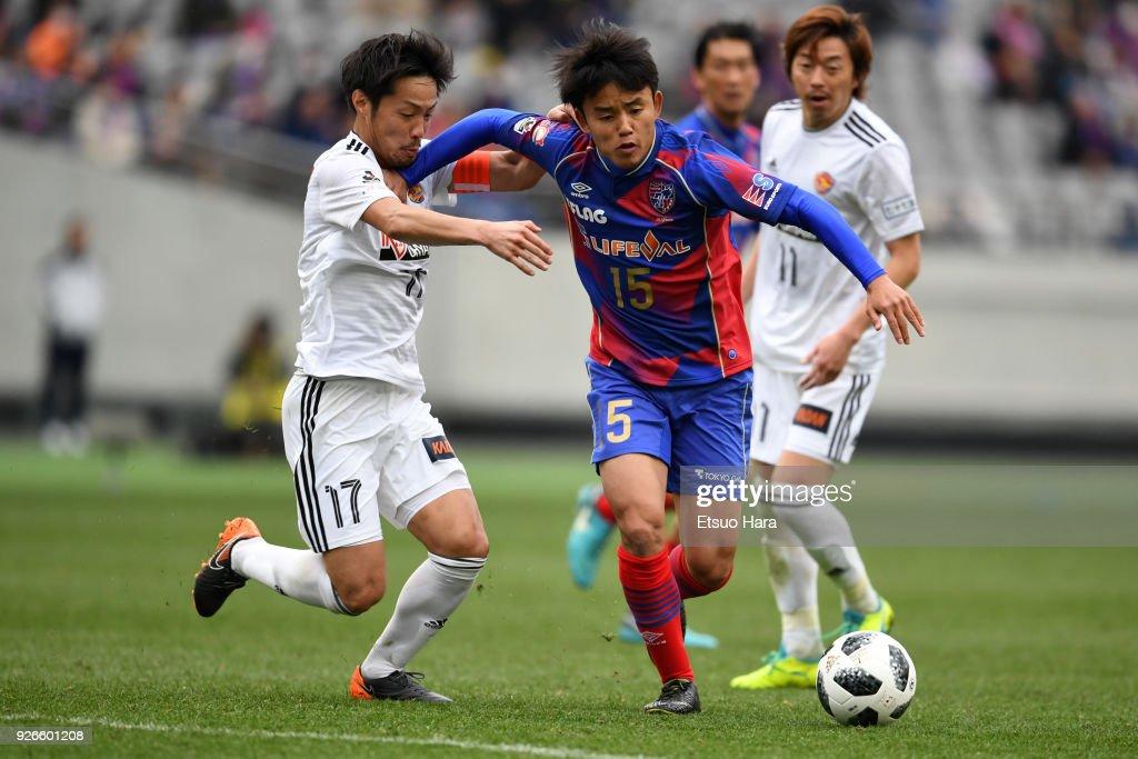 Takefusa Kubo #15 of FC Tokyo and Shingo Tomita (L) of Vegalta Sendai compete for the ball during the J.League J1 match between FC Tokyo and Vegalta Sendai at Ajinomoto Stadium on March 3, 2018 in Chofu, Tokyo, Japan.