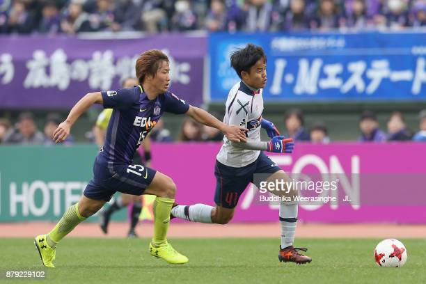 Takefusa Kubo of FC Tokyo and Sho Inagaki of Sanfrecce Hiroshima compete for the ball during the JLeague J1 match between Sanfrecce Hiroshima and FC...