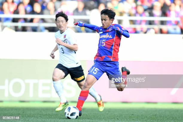 Takefusa Kubo of FC Tokyo and Tomoya Ugajin of Urawa Red Diamonds compete for the ball during the JLeague J1 match between FC Tokyo and Urawa Red...