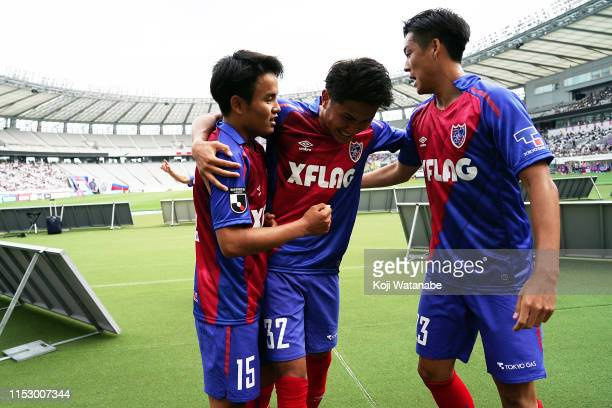 Takefusa Kubo of FC Tokyo celebrates scoring his team's third goal with teammate during the JLeague J1 match between FC Tokyo and Oita Trinita at...