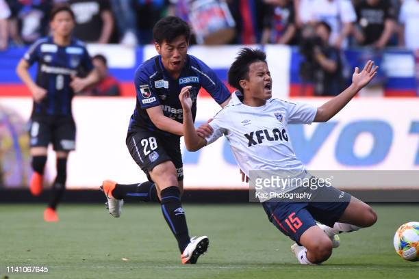 Takefusa Kubo of FC Tokyo fouled Takahiro Ko of Gamba Osaka during the J.League J1 match between Gamba Osaka and FC Tokyo at Panasonic Stadium Suita...