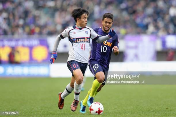 Takefusa Kubo of FC Tokyo takes on Felipe Silva of Sanfrecce Hiroshima during the JLeague J1 match between Sanfrecce Hiroshima and FC Tokyo at Edion...