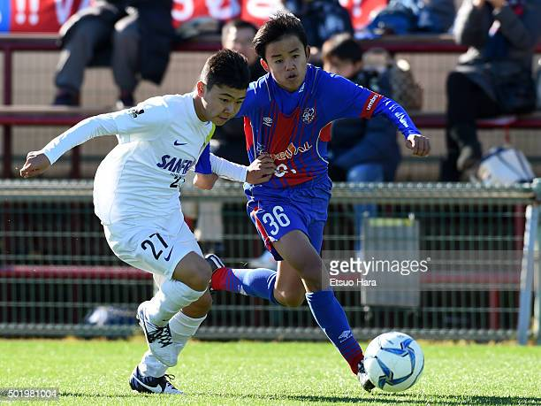 Takefusa Kubo of FC Tokyo U15 Musashi and Masato Matsuzaki of Sanfrecce Horoshima Junior Youth in compete for the ball during the Prince Takamado...