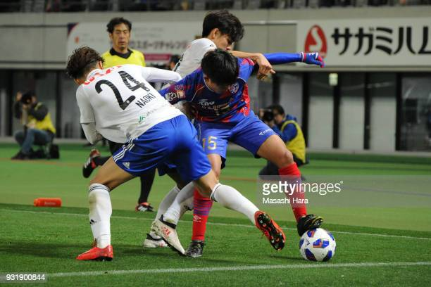 Takefusa Kubo of FC TokyoNaoki Kawaguchi and Go Hayama of Albirex Niigata compete for the ball during the JLeague YBC Levain Cup Group A match...
