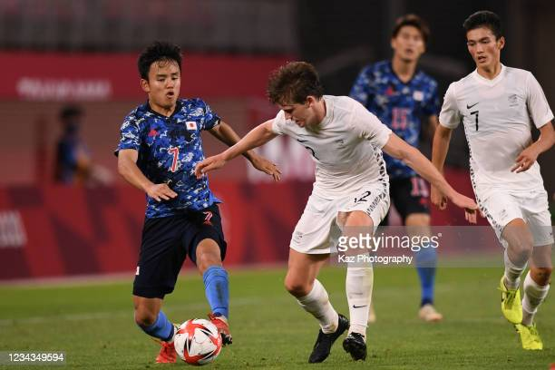 Takefusa Kubo of Japan and Callum Mccowatt of New Zealand compete for the ball during the Men's Quarter Final match on day eight of the Tokyo 2020...
