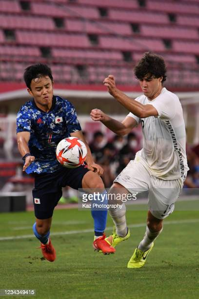 Takefusa Kubo of Japan and Matthew Garbett of New Zealand compete for the ball during the Men's Quarter Final match on day eight of the Tokyo 2020...