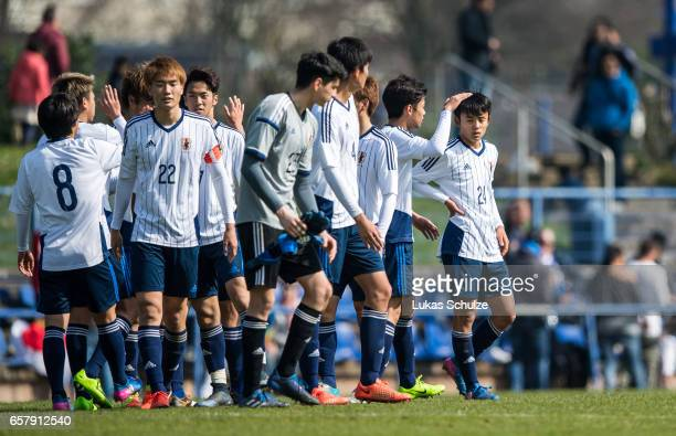 Takefusa Kubo of Japan and team mates shake hands after winning a Friendly Match between MSV Duisburg and the U20 Japan on March 26 2017 in Duisburg...