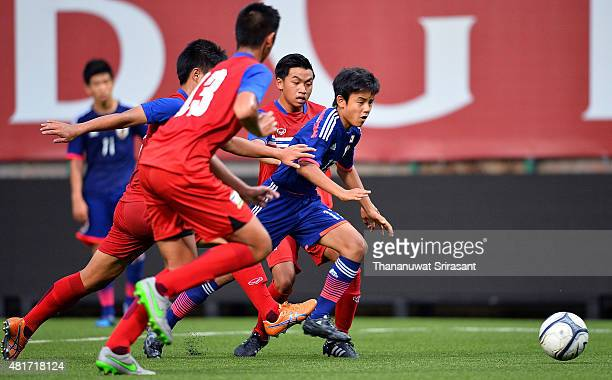 Takefusa Kubo of Japan competes for the ball during the friendly match between Thailand U16 and Japan U15 at Leo Stadium on July 23 2015 in Bangkok...