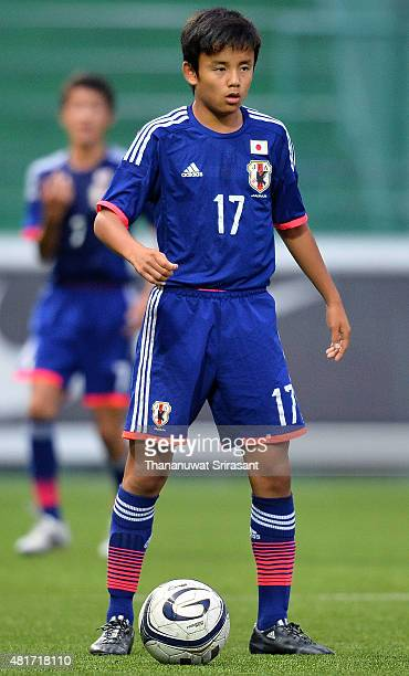 Takefusa Kubo of Japan holds the ball during the friendly match between Thailand U16 and Japan U15 at Leo Stadium on July 23 2015 in Bangkok Thailand