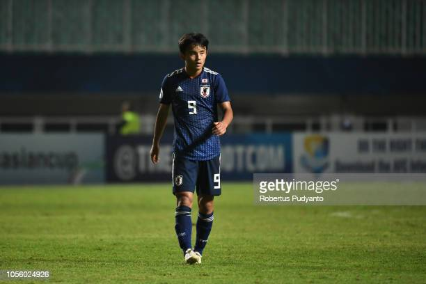 Takefusa Kubo of Japan in action during the AFC U19 Championship Indonesia semi final match between Japan and Saudi Arabia at Pakansari Stadium on...