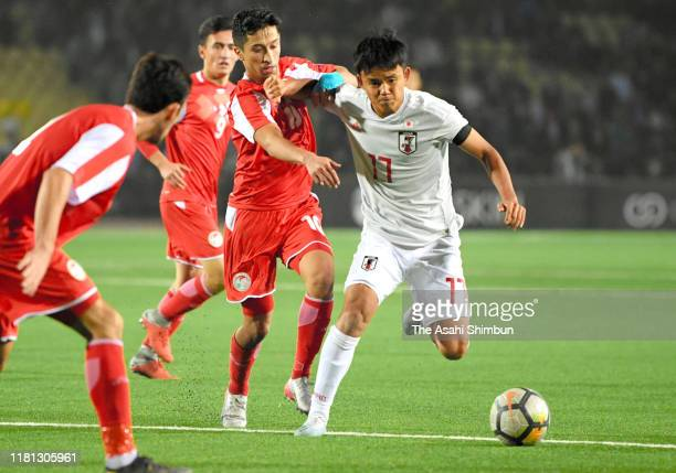 Takefusa Kubo of Japan in action during the FIFA World Cup Asian Qualifier second round Group F match between Tajikistan and Japan at the Central...