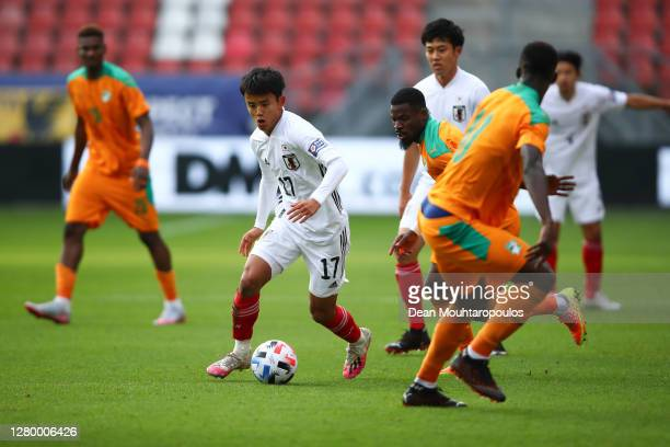 Takefusa Kubo of Japan in action during the international friendly match between Japan and Ivory Coast at Stadion Galgenwaard on October 13, 2020 in...