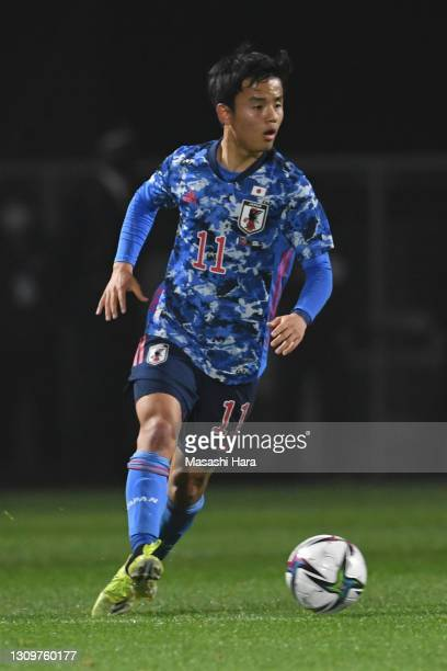 Takefusa Kubo of Japan in action during the U-24 international friendly match between Japan and Argentina at the Kitakyushu Stadium on March 29, 2021...