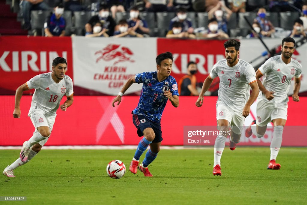 Takefusa Kubo of Japan in action under pressure from Marco ...