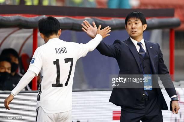 Takefusa Kubo of Japan, Japan coach Hajime Moriyasu during the friendly match between Japan and Ivory Coast at Stadium Galgenwaard on October 13,...