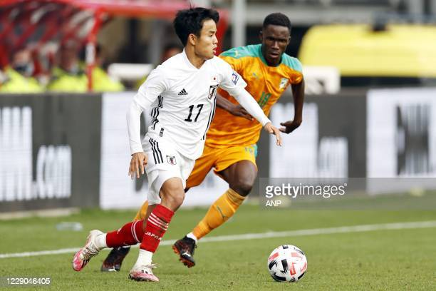Takefusa Kubo of Japan, Odilon Kossounou or Ivory Coast during the friendly match between Japan and Ivory Coast at Stadium Galgenwaard on October 13,...