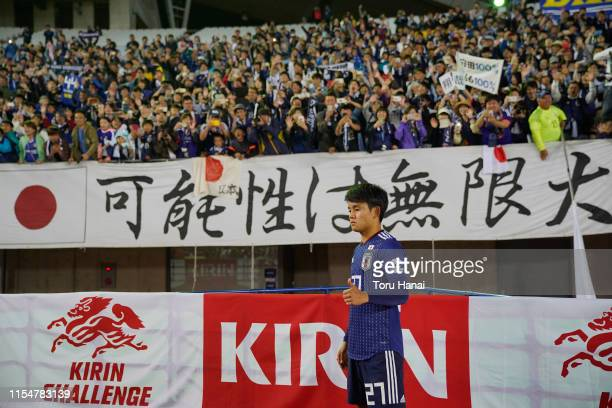 Takefusa Kubo of Japan poses for photographers in front of supporters after defeating El Salvador during the international friendly match between...