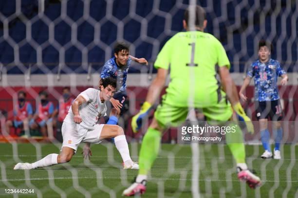 Takefusa Kubo of Japan shoots the ball under the challenge from Jesus Vallejo of Spain at Saitama Stadium on August 3, 2021 in Saitama, Japan.