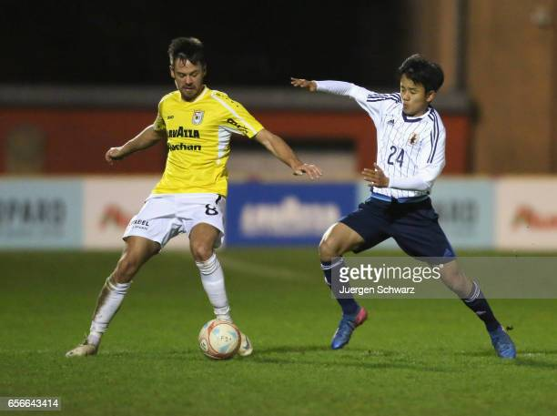 Takefusa Kubo of Japan tackles Mario Pokar of F91 during a friendly soccer match between F91 Diddeleng and the Japan U20 team at Stade Jos Nosbaum on...