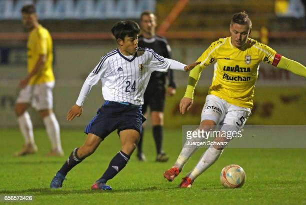 Takefusa Kubo of Japan tackles Tom Schnell of F91 during a friendly soccer match between F91 Diddeleng and the Japan U20 team at Stade Jos Nosbaum on...