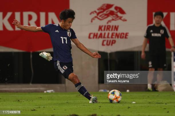 Takefusa Kubo of Japan takes a free kick during the international friendly match between Japan and Paraguay at Kashima Soccer Stadium on September 05...