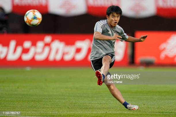 Takefusa Kubo of Japan warms up prior to the international friendly match between Japan and El Salvador at Hitomebore Stadium Miyagi on June 09 2019...