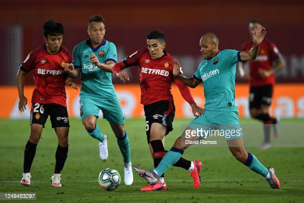 Takefusa Kubo of RCD Mallorca battles for possession with Arthur Melo of FC Barcelona during the La Liga match between RCD Mallorca and FC Barcelona...