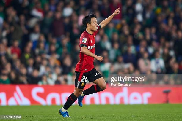 Takefusa Kubo of RCD Mallorca celebrates scoring his team's third goal during the Liga match between Real Betis Balompie and RCD Mallorca at Estadio...