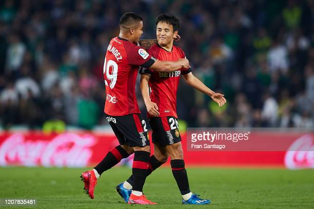 Takefusa Kubo of RCD Mallorca celebrates scoring his team's third goal with Cucho Hernandez during the Liga match between Real Betis Balompie and RCD...