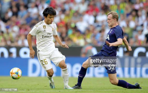 Takefusa Kubo of Real Madrid and Oliver William Skipp fight for the ball during the Audi cup 2019 semi final match between Real Madrid and Tottenham...