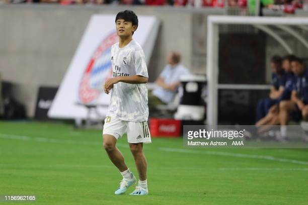 Takefusa Kubo of Real Madrid warms up before the 2019 International Champions Cup match between FC Bayern Munich and Real Madrid at NRG Stadium on...