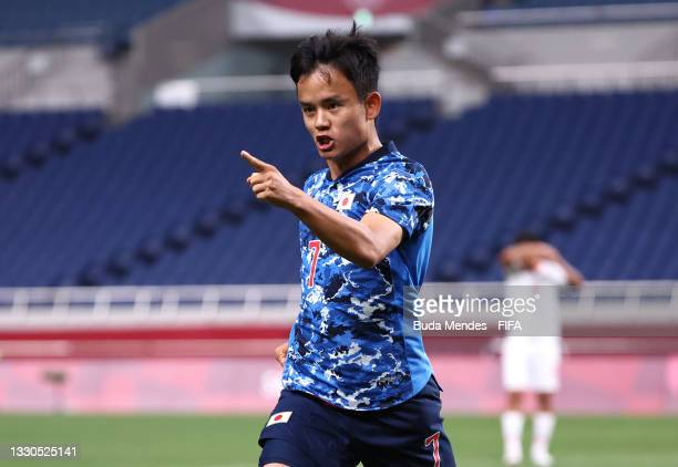 Takefusa Kubo of Team Japan celebrates after scoring their side's first goal during the Men's First Round Group A match between France and South...