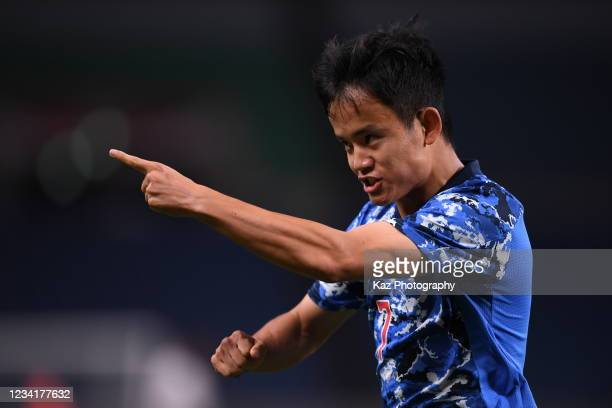 Takefusa Kubo of Team Japan celebrates the opner during the Men's First Round Group A match on day two of the Tokyo 2020 Olympic Games at Saitama...