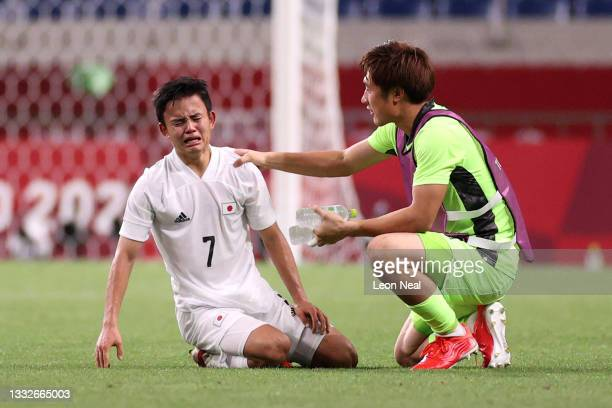 Takefusa Kubo of Team Japan looks dejected as he is consoled by Keisuke Osako of Team Japan following defeat in the Men's Bronze Medal Match between...