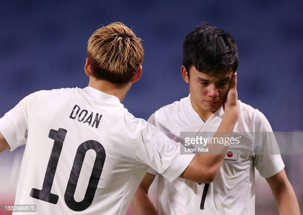 Takefusa Kubo of Team Japan looks dejected as he is consoled by Ritsu Doan following defeat in the Men's Bronze Medal Match between Mexico and Japan...