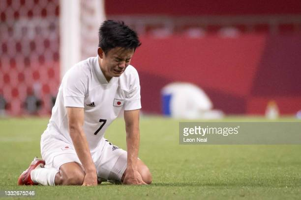 Takefusa Kubo of Team Japan looks dejected following defeat in the Men's Bronze Medal Match between Mexico and Japan on day fourteen of the Tokyo...