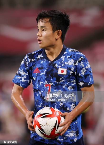 Takefusa Kubo of Team Japan prepares to take a throw in during the Men's Quarter Final match between Japan and New Zealand on day eight of the Tokyo...