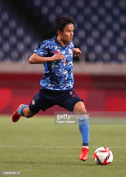 Takefusa Kubo of Team Japan runs with the ball during the Men's First Round Group A match between Japan and Mexico on day two of the Tokyo 2020...