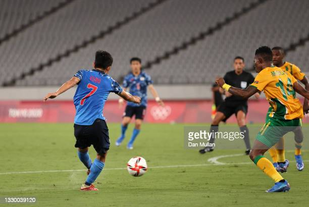 Takefusa Kubo of Team Japan scores their side's first goal during the Men's First Round Group A match between Japan and South Africa during the Tokyo...