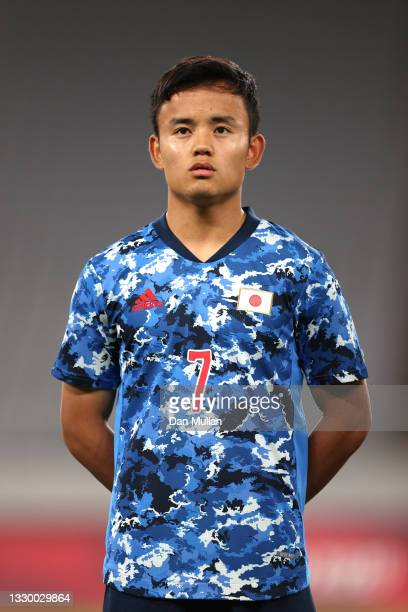 Takefusa Kubo of Team Japan stands for the national anthem prior to the Men's First Round Group A match between Japan and South Africa during the...