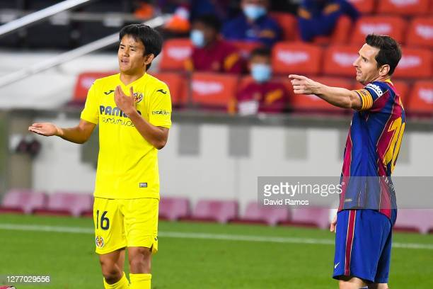 Takefusa Kubo of Villarreal CF and Lionel Messi of FC Barcelona react during the La Liga Santander match between FC Barcelona and Villarreal CF at...