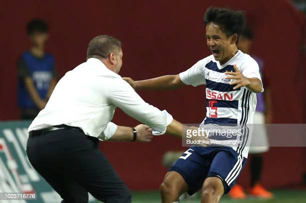 Takefusa Kubo of Yokohama F Marinos celebrates with his team head coach Ange Postecoglou after scoring his side's first goal during the JLeague J1...